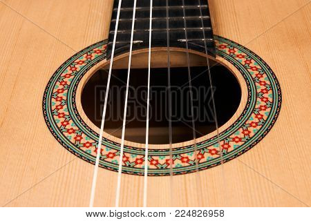 Acoustic guitar with nylon strings, close-up. Classical acoustic guitar. Six stringed musical instrument