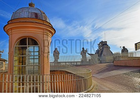 Vatican, Italy - January 22: view of the buildings and statues of the apostles on the roof of St. Peter's Basilica on January 22, 2018, Vatican, Rome, Italy