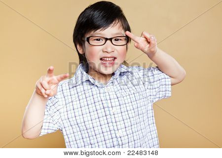 A portrait of a cute asian boy making a funny face