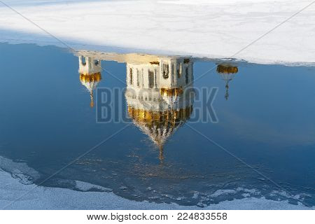 Moscow, Russia - February 01, 2018: Reflection of Cathedral of Christ the Saviour in Moskva river at sunny winter morning