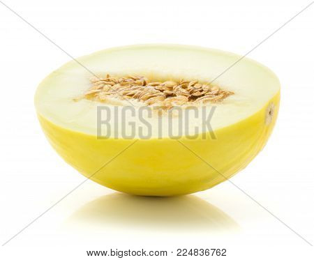 One yellow honeydew melon half with seeds isolated on white background