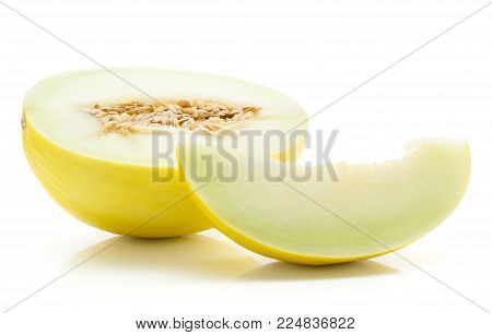 One yellow honeydew melon half with seeds, one seedless slice, isolated on white background