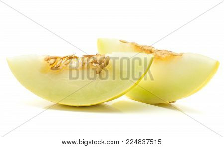 Yellow honeydew melon two slices with seeds isolated on white background
