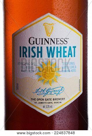 LONDON, UK - FEBRUARY 02, 2018: Bottle lable of Guinness Irish Wheat beer on white background.