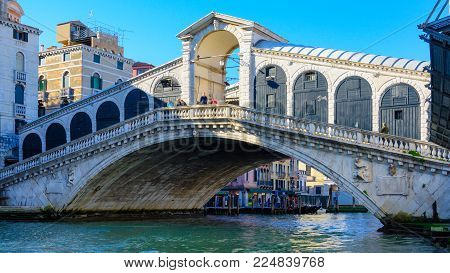 The Rialto bridge connecting San Marco and San Polo, Venice,Italy 2015.The Rialto Bridge is the oldest of the four bridges spanning the Grand Canal in Venice, Italy.