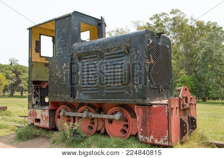 old locomotive stationed and abandoned in the park
