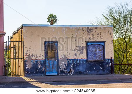 Abandoned Adobe Building With Boarded Up Window