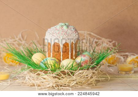 Pastel And Colorful Easter Eggs And Easter Cake. Easter Eggs Painted In Pastel Colors Lying On The M