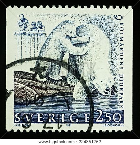 Moscow, Russia - February 02, 2018: A stamp printed in Sweden shows Polar Bears (Ursus maritimus) in zoo, series