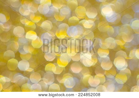 Gold yellow bright sparkling background.  Celebrate Holiday or special occasion with twinkle and glitter of this abstract textured colorful backdrop.