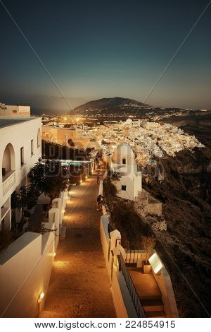 Santorini skyline and street at night with buildings in Greece.