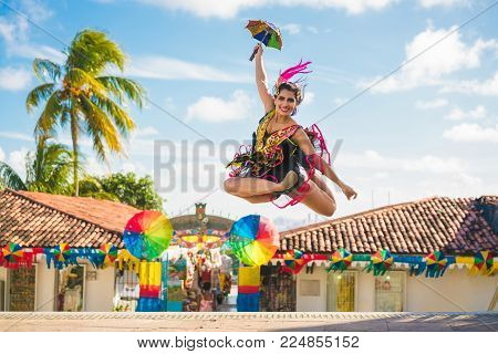 Brazilian Carnival. Woman wearing carnival costumes and dancing in Olinda, Pernambuco, Brazil.