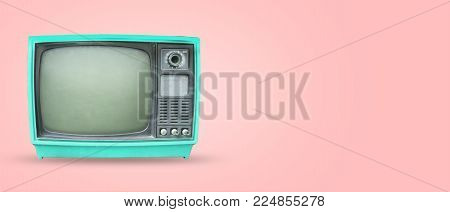Retro television - old vintage tv on pastel color background. retro technology. flat lay, top view hero header. vintage color styles.