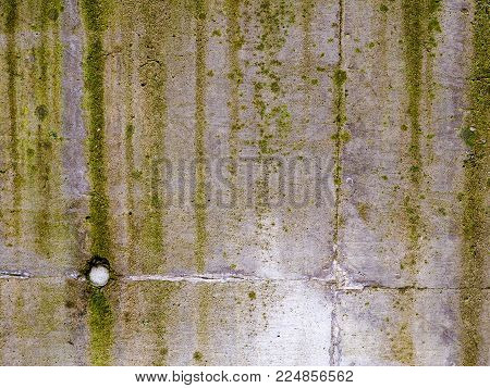 Moss And Mold Streak Down A Concrete Wall. Green And Black Streaks Of Moss And Mold Run Down A Reinf