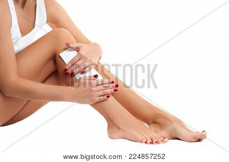 Depilation and Hair Removal. Woman is waxing her legs