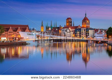 GDANSK, POLAND - JUNE 21, 2017: Old town in Gdansk and catwalk over Motlawa river at sunset, Poland. Gdansk is the historical capital of Polish Pomerania.