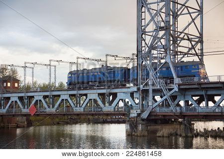 Train on the steel double-deck drawbridge over the Pregolya River in Kaliningrad (Konigsberg), Russia. The bridge was built in the 1913-1926 and was reconstructed in 1959-1965.