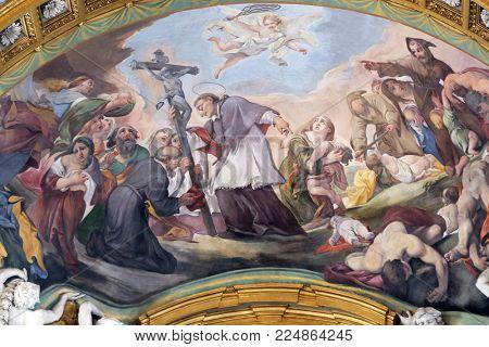 ROME, ITALY - SEPTEMBER 03: St. Charles Borromeo Combating the Plague by Pietro da Cortona in Basilica dei Santi Ambrogio e Carlo al Corso, Rome, Italy on September 03, 2016.