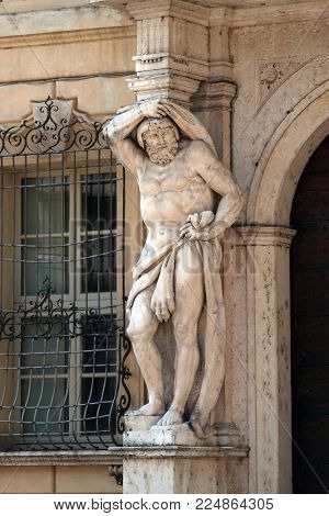 MANTUA, ITALY - JUNE 04: Statue of Hercules at the entrance to the 18th century Palazzo Vescovile (Bishops Palace) in the historical center of Mantua, Italy on June 04, 2017.