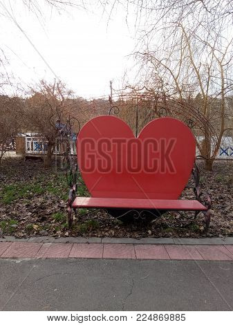 valentine heart bench in a park, Red heart shaped bench