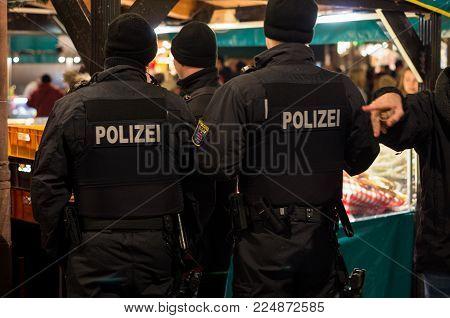 Frankfurt am Main, Hessen, Germany - November 29, 2017: Police patrol in Christmas market in Frankfurt am Main, Germany