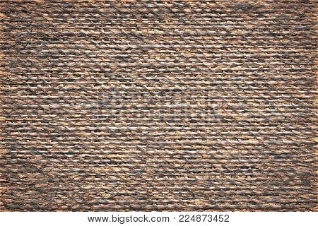 illustration of speckled abstract texture of fabric or textile material of brown color for a background or for desktop wallpaper