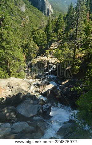 Magnificent River Surrounded By Infinite Rocks In The Yosemite National Park. Nature Travel Holidays. June 29, 2017. Yosemite National Park. Mariposa California. USA. EEUU