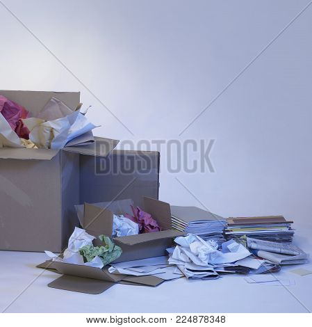 wastepaper and paper boxes in blue ambiance