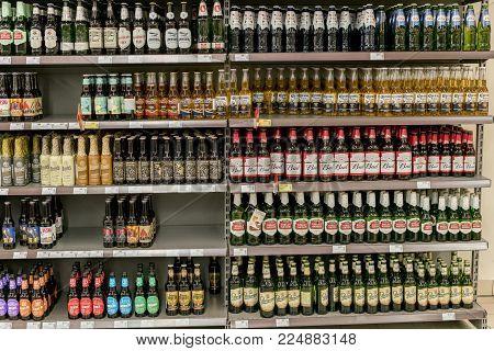 Kiev, Ukraine. February 1 2018. Different types of beer on the shelves in the supermarket