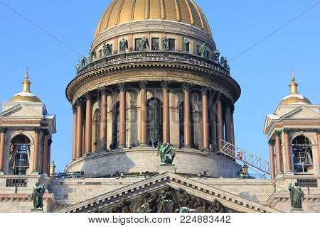 St. Petersburg Saint Isaac's Cathedral Dome Colonnade Close Up View. Orthodox Church and Religious Landmark in Russia. Classical Monumental Basilica Building Architecture on Clear Blue Sky Background.