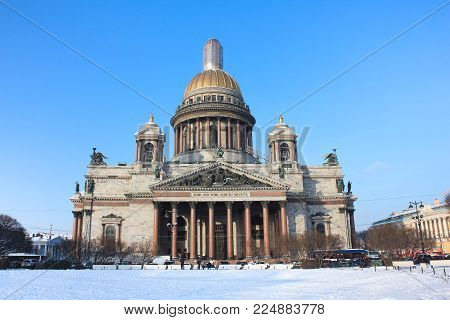 Saint Isaac's Cathedral Building in St. Petersburg, Russia. Vintage Style Vivid Bright Wallpaper, Winter Scene with Famous Russian Church on Sunny Day with Empty Clear Blue Sky Background.