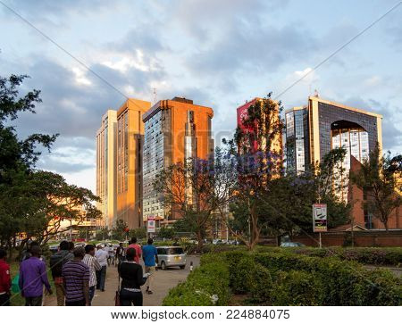 NAIROBI, KENYA-NOVEMBER 8, 2015: Unidentified pedestrians walk through the central area of Nairobi downtown district.