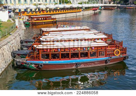 CLARKE QUAY, SINGAPORE - AUGUST 17, 2009: Traditional bumboats moored alongside Clarke Quay on the Singapore River.