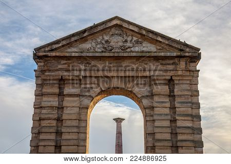 Porte d'Aquitaine (Aquitaine Gate) with its symbolic arch and column on Place de la Victoire Square in Bordeaux, France. It is one of the landmarks of the old Bordeaux, and a former entrance to the city.