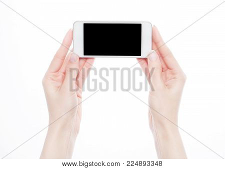 Female hands holding smartphone isolated on white background.