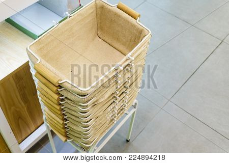 Retail industry and small business concept, empty shopping basket stacked to provide customers in the supermarket.