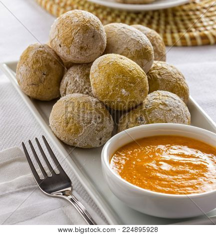 Wrinkled potatoes called papas arrugadas with spicy mojo sauce, typical food from the Canary Islands, Spain poster