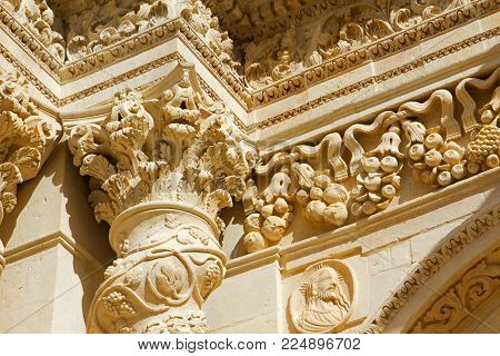 This image represent a column and capital with decoration of the sicilian church in Palazzolo Acreide town. Sicily.