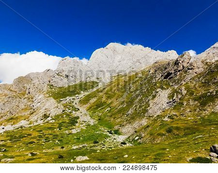 Rocky mountains, southern italy, against blue sky and white clouds