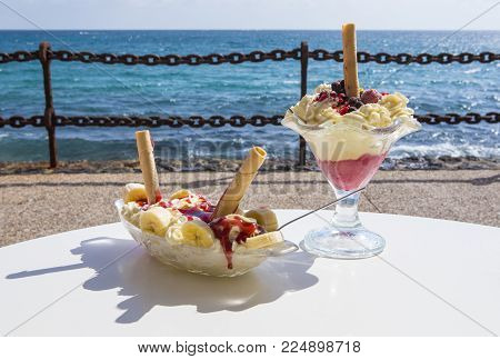 Two Ice Cream Sundaes Served In The Sunshine By The Sea.