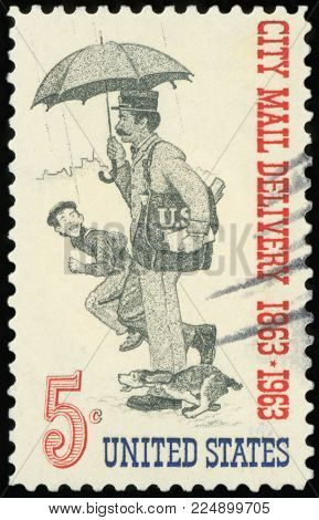 UNITED STATES OF AMERICA - CIRCA 1963: A stamp printed in USA dedicated to the Free City Mail Delivery Centenary shows Letter Carrier, circa 1963