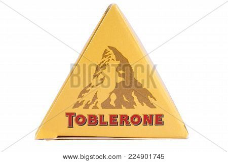 LONDON, UK - DECEMBER 18TH 2017: A close up of the Toblerone logo on the products packaging, on 18th December 2017.  Toblerone is a Swiss chocolate bar brand owned by Mondelez International Inc.