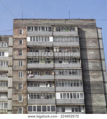 Grunge apartment building. Multistory. Apartment block. Large building