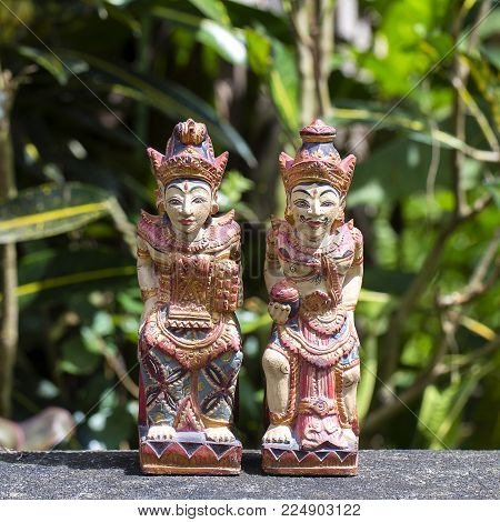 Two old mythical wooden figures in island Bali, Indonesia. Close up