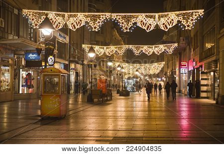 BELGRADE, SERBIA - DECEMBER 07, 2017: Decorative lighting in Knez Mihailova Street for New Year's eve celebration with entertainment program. Belgrade, Serbia, on December 07, 2017.