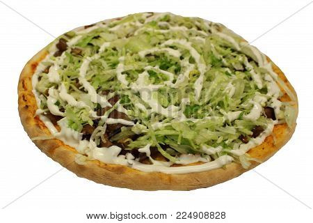 Kebab pizza. Pizza with tomato sauce, mozzarella, kebab, salad, dressing.