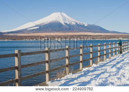 Beautiful landscape view of Fuji mountain or Mt.Fuji covered with white snow in winter seasonal at Yamanaka Lake, Japan.
