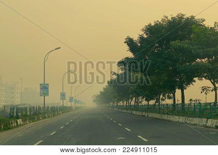 KOLKATA, WEST BENGAL , INDIA - NOVEMBER 27TH 2016 : Rajarhat and Newtown road of Kolkata - a road to Kolkata airport. Winter moring shot.