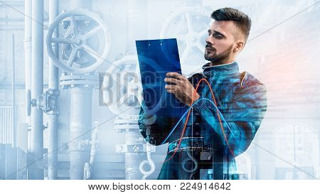 Portrait Of Manager With The Tablet On Factory Background