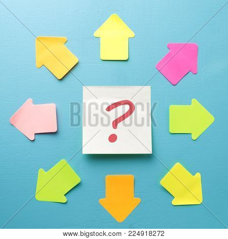 Sticker with question mark and many arrows. Concept of choosing a direction